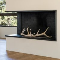 Steel fireplace surround and hearth by Green Star Builders