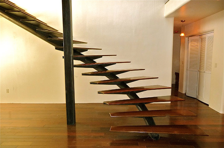 Winding Staircase: Helical Steel Spine, Walnut Treads and Open Rise